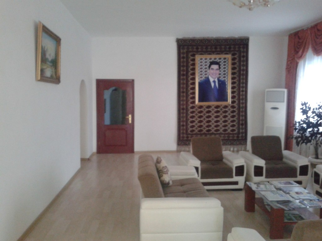 Lobby of the Uzboy hotel. The current president is omnipresent