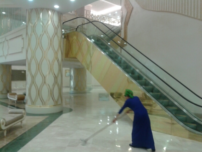 Cleaning staff in blue dresses