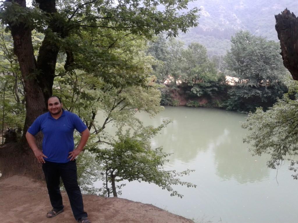 Amir at the mountain lake