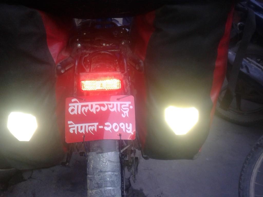 "The sign says: ""Wolfgang - Nepal 2015"". We both got one in Kathmandu."