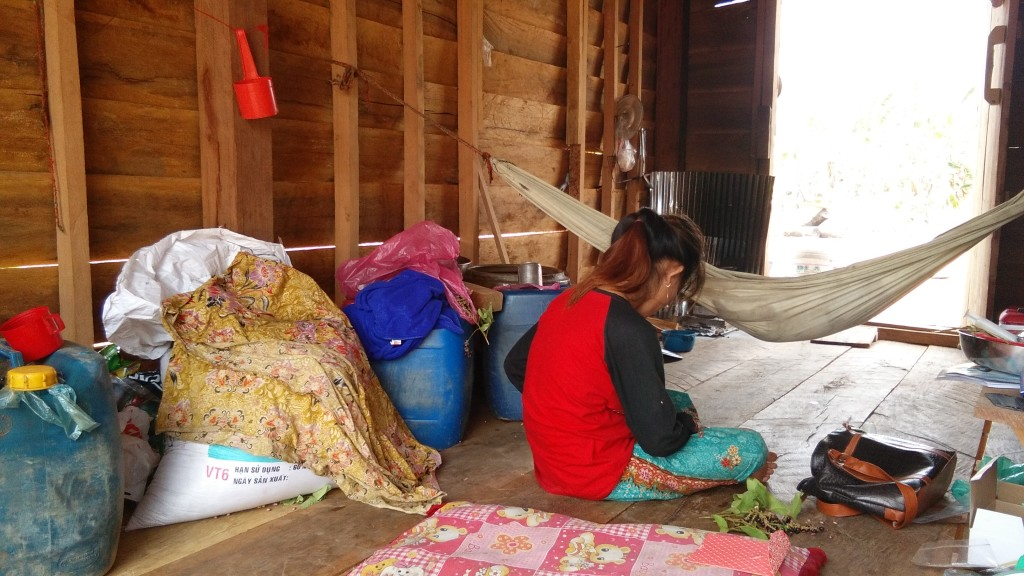 Woman in hut with baby...