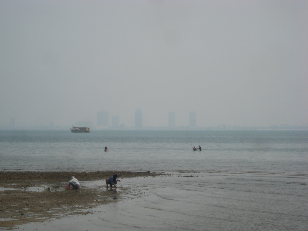 Fisherman in front of the skyline of Pattaya