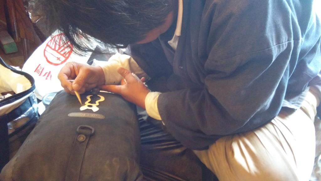 Masataka painting on my pannier