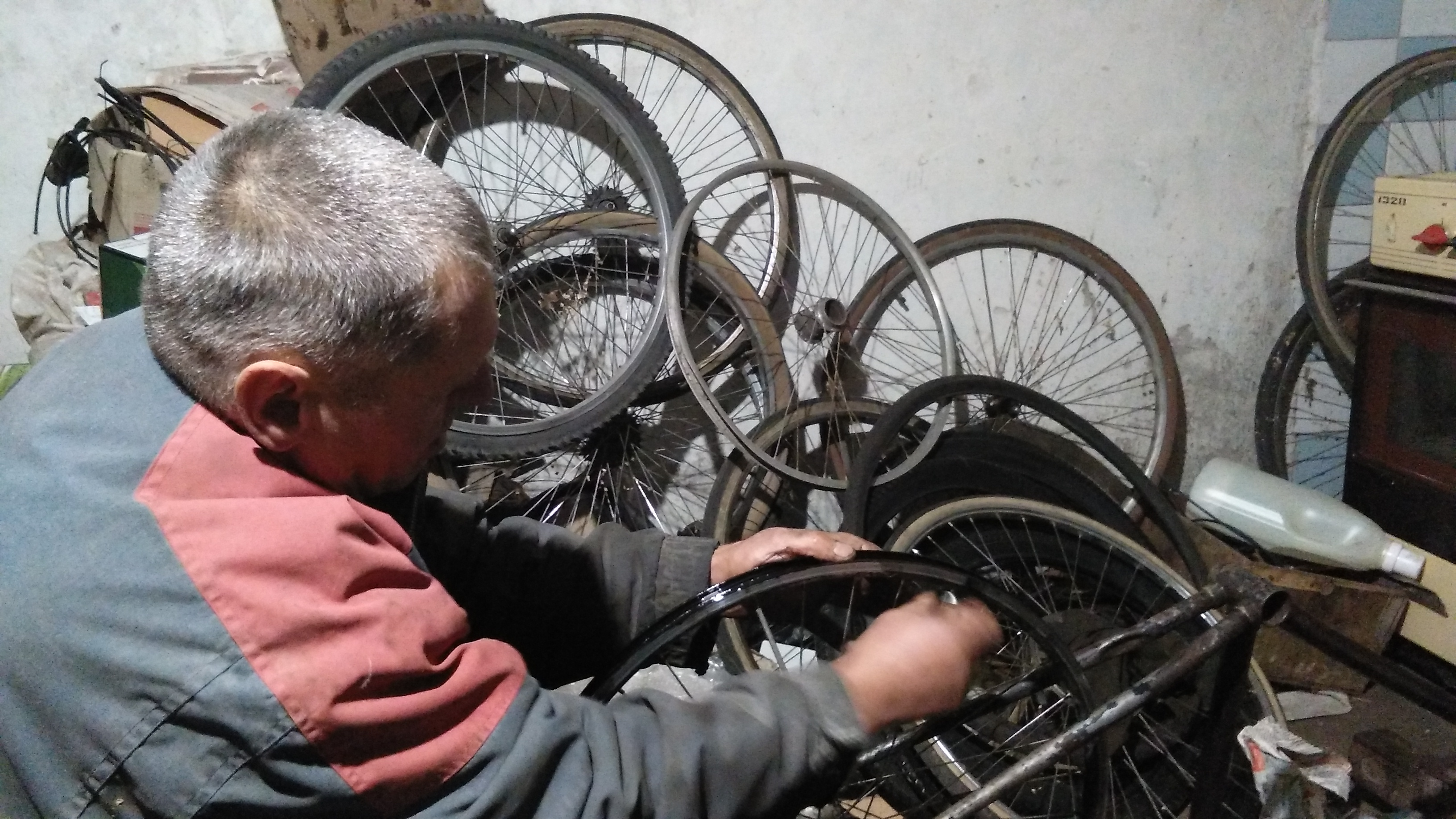 Vladimir fixing my wheel in his workshop